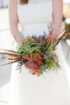 Succulent, air plant and feather bouquet by Layers of Lovely