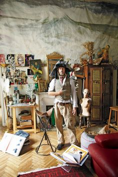 Julien d'Ys dressed in a Galliano hat inside his eclectic Paris studio. Photographed by Robert Fairer, Vogue, January 2011.