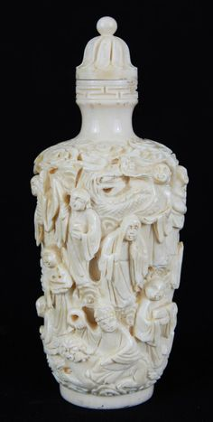 Chinese ivory perfume bottle. Tiny chip where the ivory cap is. Very detailed…