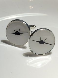 Looking for a unique aviation gift? These cufflinks are the perfect gift for the aviation lover in your life. Available in any aviation platform, please make sure to comment which airplane you would like if it is something other than the F-18 Hornet. Custom color combinations are also available upon request.  Size 16mm