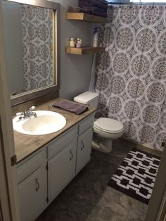 Bathroom remodel on a budget:  vinyl tile floors, Ardex Feather Finish concrete countertop, DIY wood frame mirror, floating wood shelves
