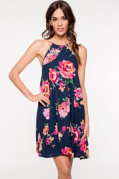 - 100% Polyester - Fully lined - Halter neckline - Bright floral print detail - Keyhole button closure detail on back - Hand wash - Model is wearing size Small