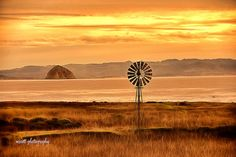 Morro bay and the rock of Morro guarded by the most enchanting windmill..Landscape Photography  by MScottPhotography on Etsy #morrobay