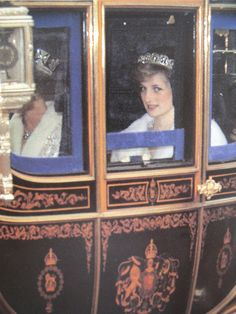 November 4, 1982: Princess Diana with Queen Elizabeth II riding in a coach leaving after the State Opening of Parliament.