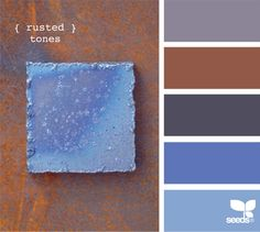 rusted tones    03.12.12 bright blue and greys for wall tones, leather and wood accents.