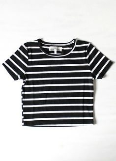 Quality knitted crop top features black and white stripes all over. The fit is semi-fitted and so comfortable. Material is a little thick. Not sheer or see-through at all. Pair this crop top with highwaisted shorts or destroyed boyfriend jeans and strappy heels for a totally classy, chic, and basic look!  Imported