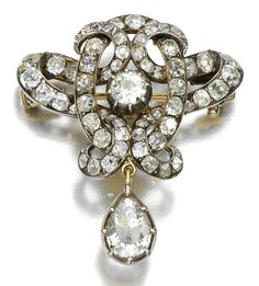 DIAMOND BROOCH, LATE 19TH CENTURY.  Of open work scroll design set with circular-cut and cushion-shaped diamonds, suspending a detachable pear-shaped diamond drop, later brooch pin to reverse.