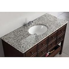 @Overstock - This beautiful dark-brown 48-inch bathroom vanity is defined by its striking walnut-brown finish and antique nickel round knobs. It would suit both modern and contemporary decor and its two beautiful wicker drawers provide ample storage space.http://www.overstock.com/Home-Garden/New-Haven-48-inch-Bath-Vanity/6771719/product.html?CID=214117 $924.99