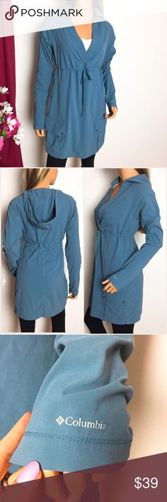 "Columbia • blue hoodie jacket/tunic dress Muted blue long sleeve hoodie tunic dress by Columbia.  Has drawstring empire waist, thumb holes, vented pits, 2 large snap button pockets w 2 smaller pockets on skirt, lightweight comfortable stretchy fabric. Good for a misty drizzly kind of day like Seattle weather.   Condition: gently used, no flaws, great condition overall  Size: S (fits like Med-small) Chest: 20.5 inches across  Length: 32.5"" Arms: 22"" pit to cuff Fabric: nylon & elastane…"