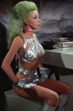 Star Trek.  Angelique Pettyjohn. Sexy silver outfit. Collar.