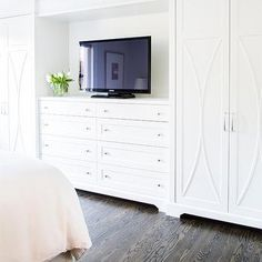 Bedroom Built In Dresser Flanked by Wardrobe Cabinets