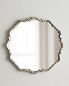"""Valentia Mirror at Horchow.  33"""" diameter $296.    plated oxidized silver finish with rust-gray wash"""