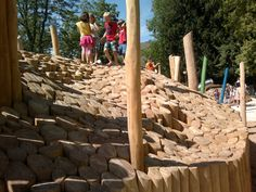Made of smoothed logs, set on end. An undulating surface--kukuk creative natural playgrounds tilted surfaces