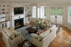 Traditional Living Room with Office star - Brighton Coffee Table, Built-in bookshelf, Standard height, stone fireplace
