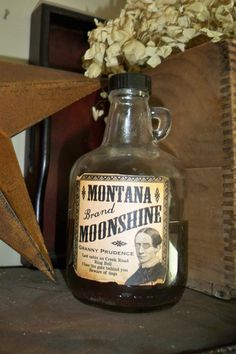 Montana Moonshine vintage bottle jug whiskey bottle saloon old west ooak rustic primitive decor made in Montana. $8.50, via Etsy.