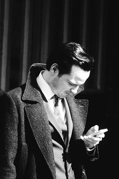 Andrew Scott as Moriarty on the Sherlock Series 3 set...wearing Sherlock's coat! What!