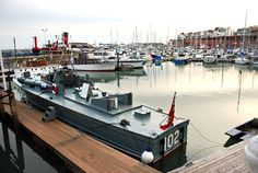 Torpedo Boat MTB 102 at Ramsgate on 20th September 2012 Local residents will have noticed a striking visitor to the Royal Harbour this week, in the form of MTB 102, a historic torpedo boat. Ramsgate Maritime Museum was pleased to host this historic vessel it's heritage pontoons in the Royal Harbour for several days.