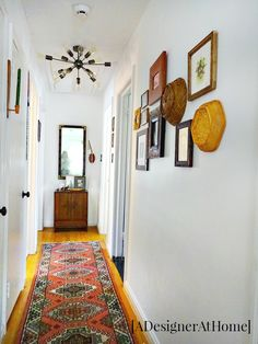homey cozy touches, vintage details and a gallery wall for this bright hallway