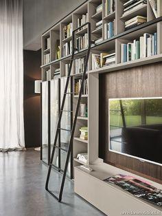 Custom made minimal blackened steel bookshelves with - Libreria a scala ikea ...