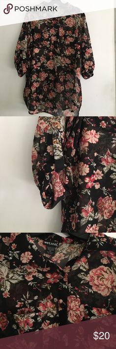 🌺floral print blouse🌺 Used great condition black floral print, see through shirt half sleeve🌺 two pocket on the front Wet Seal Tops Blouses