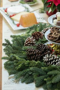 A Christmas wreath is perfect for decorating the table! Place a plate or tower inside and it's instant table decor!