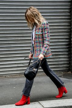 Red boots, tweed jacket, Chanel bucket bag.