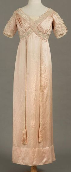Shell pink silk satin evening dress with pearl bead embellishment, by Liberty & Co., English, c. 1910.