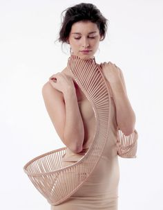 Body Jewellery by Stephanie Bila. Bila used a flexible beech timber to create the ribbed forms, which recall organic structures like shells and skeletons. Swarovski crystals also line the thin edges of some of the pieces.