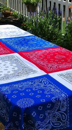 Love this! Beautiful and festive in red, white and blue, this color block bandana tablecloth is sized for picnic tables and will set the party mood. Perfect for Memorial Day and 4th of July! | summer entertaining idea tip