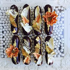 Fall Eclair collection oh so pretty. Belgium chocolate ganache, fresh made custard and airy pâte à choux makes this one heavenly Eclair! #onlythebestforourclients #ecliars #fall #design #desserts #finedesserts #fancy #falldesign #floral #floraldesserts #french #frenchdesserts #glendale #gift #modernluxury #beautiful