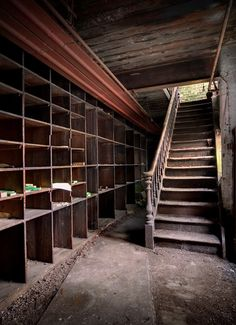 SUMMITING THE TOOL MAKERS The final set of stairs giving access to the attic spaces at this very old and long derelict tool makers factory. There were even more shelving and parts stored up there.
