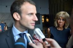 French Economy and Industry minister Emmanuel Macron (L) answers ...
