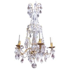 A French 19th Century Louis XVI Style Bronze Dore and Crystal Chandelier   From a unique collection of antique and modern chandeliers and pendants  at https://www.1stdibs.com/furniture/lighting/chandeliers-pendant-lights/