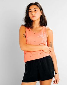 The Nora top in fusion coral is the perfect summer vest. This sleeveless style from Dedicated is printed in a tiny palm tree print on a pinky orange Chino Shorts, Bikini Panty, Hot Girls, Nora, Ecology Design, Palm Tree Print, Palm Trees, Summer Vest, Bustiers