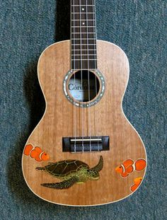 The art of Edgardo Garcia II and family - turtle and clownfish ukulele