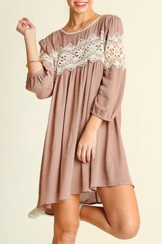 Classic babydoll style dress with a delicate lace accent across the top make this dress a stunner. Comfortable and adorable this dress is perfect for warmer weather paired with sandals or heels or a super cute look for fall with boots.  Baby Doll Dress by Umgee USA. Clothing - Dresses Washington