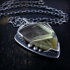 star rutile quartz by Purified Bill, via Flickr; I like the honeycomb details on the bezel