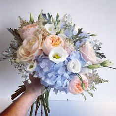 Pink peach and blue bridal bouquet including Hydrangea and Roses. Designed and created by The Floral Design Boutique, Scotland.