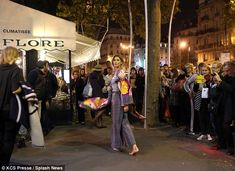 Ever the professional: The mother-of-two didn't allow the crowd of onlookers to distract h...