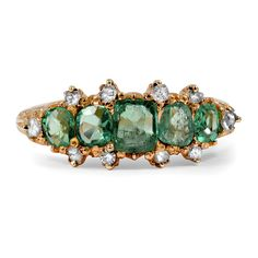 The Isolde Ring from Brilliant Earth This Victorian beauty in rose gold boasts a cushion shaped natural emerald, four cushion shaped natural emerald accents, and ten rose cut diamond accents in a truly breathtaking cluster. Sculpted scrolling in the shoulders completes this immaculate piece (approx. 0.23 total carat weight).