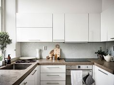 Tour a Tiny One-Room Apartment Making a Case for Small Space Living - Nordic Design Small Space Living, Small Spaces, One Room Apartment, Apartment Ideas, Kitchen Dining, Kitchen Cabinets, Make A Case, Simple Colors, Nordic Design