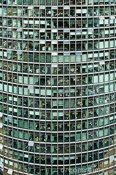 Exterior of glass windows on modern office skyscraper building.