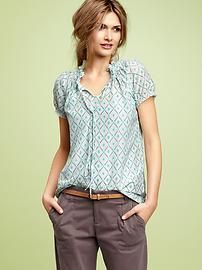 I have this top in two colors.  Practical and stylish.  I actually wear it with the strings tied.