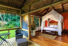 Peeking out from between the parrot-green palms of the dense Costa Rican rainforest is Pacuare Lodge, a remote, back-to-nature eco-stay with plenty of pampering perks.