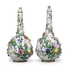 A PAIR OF MEISSEN PORCELAIN FRUIT AND FLOWER ENCRUSTED VASES AND COVERS