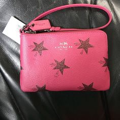 Coach Wristlet NWT Cranberry wristlet with stars. Got this as a gift for christmas and its not really my style. Perfect for a gno or as a gift Coach Bags Clutches & Wristlets