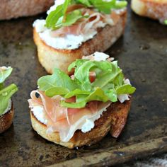 Whipped Goat Cheese Crostini with Prosciutto, Arugula & a drizzle of honey!