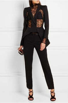 ALEXANDER MCQUEEN Cutout wool and silk-blend blazer $2,795 Seen on the Fall '16 runway - the label's acclaimed return to London Fashion Week - Alexander McQueen's neatly tailored blazer features front cutouts. Crafted from a luxurious wool and silk-blend, this Italian-made piece has precision paneling to accentuate the defined shoulders and nipped-in waist. Echo the show's romantic styling by layering yours over a lace top.   Shown here with: Lanvin Top, Versace Pants, IRO Bra top, Alexan