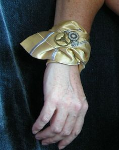 Steampunk Cuff made from Vintage Silk tie with gears and Victorian antique buttons