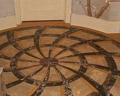 Entryway Floor   The medallion design was done on  the computer and the fabricators used the cad file to program the cuts of the stone.